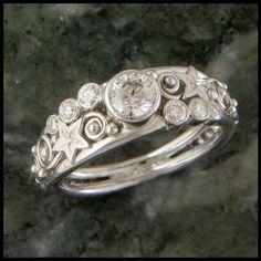 Celestial star and diamond Celtic engagement ring in 14K White Gold.