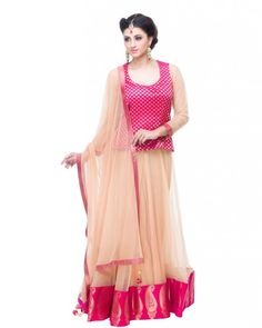 Sicily Lehenga Champagne A full skirt lehenga made with Champagne Net with a Pink brocad border featuring Gold paisleys at the bottom. The long blouse is made of silk and reaches the waist. Now available on Sololook.com #Lehenga #Traditional #DesignerWear #Ootd #Potd #Designer #FashionDesigner #IndianDesigner #ShopNow #Sololook