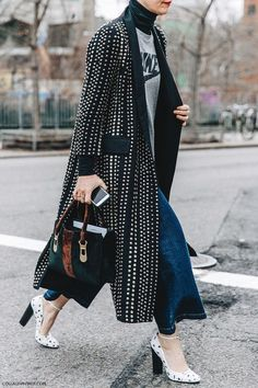long black and white patterned coat with three quarter sleeves