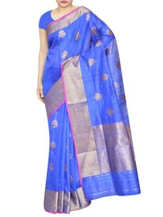 Details:  Bright blue color raw silk saree with antique gold zari broad border and antique gold petal design spread allover the saree. Specification: Length: 5.5 meters Width: 1.1 meter Blouse Piece: Yes, 80-90 cms