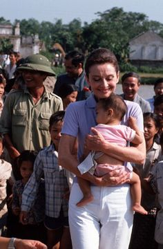 Audrey with children of Hanoi, Vietnam, 1990.