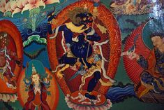 """Simhamukha (Tib. Sengdongma), known as """"the lion-headed one"""", a particularly powerful guardian dakini emanation of Padmasambhava. She is dark blue as she dances with a vajra chopper and skull cup and a khatvanga in the crook of her left elbow. Rongbuk Monastery"""