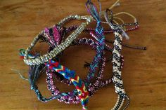"DIY Easy Friendship Bracelet Tutorial....This would be fun to do with the kids this summer. Maybe for Anna's ""Family Craft Night""?"