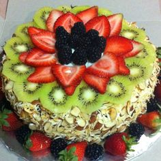 Pandan cake with fresh kiwi filling and whipped topping.