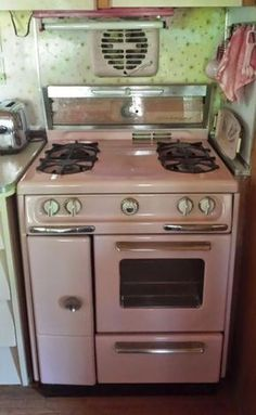 vintage-pink-stove in 1958 Universal Terra Cruiser trailer in Arizona -- the owners stripped off white paint to reveal this beauty. #vintagekitchen