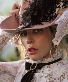 Wearing pink-stained lips, Lady Gaga wears Erdem gown and Lack of Color hat