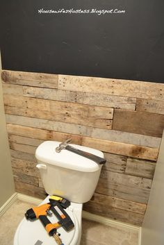 Bathroom Accent Wall- done here in pallett wood. You could even do faux brick. - interiors-designed.com