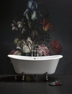 Anything but ordinary bathrooms - stunning roll top bath and an amazgins flower print wall.
