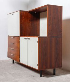 Cees Braakman; Rosewood, Lacquered Wood and Enameled Metal Cabinet for Pastoe, c1960.