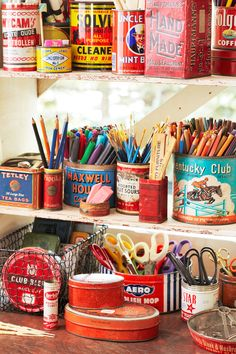 """In this case, it's markers, paintbrushes, and art pencils. """"I buy these canisters for their typography,"""" says Holden, a graphic designer by trade. """"At yard sales, they're just as cheap as plastic bins, and so much better looking.""""   - CountryLiving.com"""