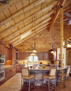 Log Home Kitchen warmth of tiles for island counter and floors