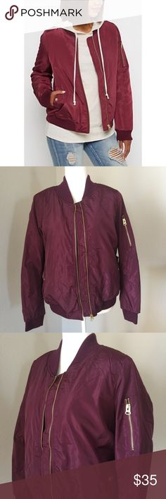 """Burgundy Utility Jacket Burgundy utility bomber jacket. Has two side pockets and gold toned zippers and hardware.   LARGE: approx 22-1/2"""" inches across bust line (laying flat) and 24"""" inches from shoulder to wrist.   MEDIUM: approx 22"""" inches across bust line and 24"""" inches from shoulder to wrist.  SMALL: 21-1/2"""" inches across the bust line (laying flat) and 24"""" inches from shoulder to wrist.  My mannequin is wearing the Large. Miss London Jackets & Coats Utility Jackets"""