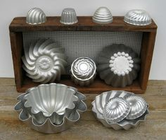 So pretty. Would make great kitchen art! Assortment of 14 Aluminum Molds  Jello  by SplendidJunkVintage, $28.00