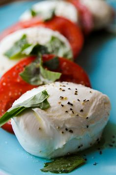 The only way I really like fresh tomatoes... paired with fresh mozzarella and copious amounts of basil. Mmm caprese.