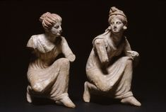 """Crouching Women Playing Knucklebones. The maidens are playing an ancient form of jacks, known as """"astragalus"""" (knucklebones), a game in which five small animal bones were tossed into the air and caught on the back of the hand. Walters Art Museum. ca. 330-100 BC (Hellenistic)"""
