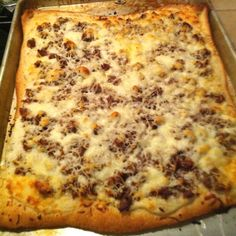 Breakfast pizza: Pillsbury pizza dough, packet of white country gravy mix, breakfast sausage, scrambled eggs, and mozzarella cheese! Bake at 400° and devour!