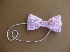 Valentine's Day Fabric Bow by MyLittleAvieBean on Etsy, $5.95. I LOVE her stuff. I am going to buy these for my 3 girls!