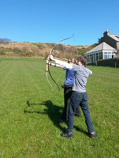 Archery in the field next to the house