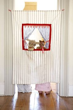 My mom made one of these for my sister and I when we were little.  She sewed the top like a curtain and used a tension rod to hang it, this way we could move it to any door wewanted : ) I think it also had puff paint...remember that @Tom John John Katie Baker?