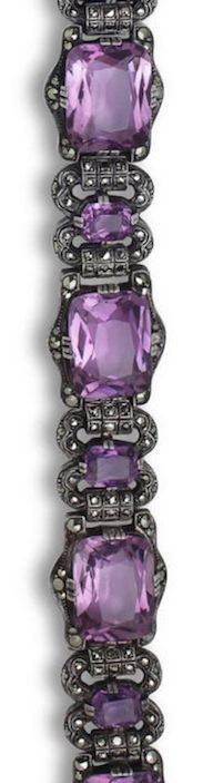 An amethyst and marcasite bracelet, Theodor Fahrner, circa 1930 designed as four horizontally-set cushion-shaped amethysts alternating with spacers of smaller vertically-set cushion-shaped amethysts, all within a marcasite border; with maker's mark TF for Theodor Fahrner; mounted in silver.
