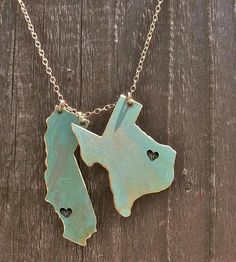 Carry two of your favorite places with you when you wear this local lovin' state necklace. Each state charm is carefully cut from solid brass, punched with a small heart to mark the city of your choice and given a vibrant verdigris patina. They're strung together on a delicate gold chain, to represent homes past and present, a faraway love or some place close to your heart.