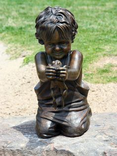 Lifesize portrait bronze memorial sculpture of little boy with a frog placed in the Children's Park Tyler, Texas, family and public monument...