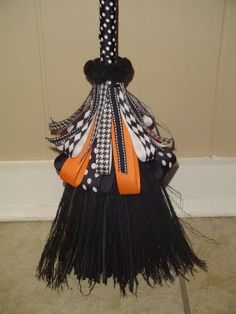 Halloween broom DIY... I want to make a broom parking area by my front door.