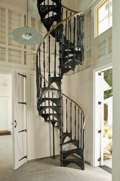 beautiful-farmhouse-style-with-metal-spiral-staircase-and-ornate-brass-railing-also-barn-door-with-black-metal-hardware-and-barn-pendant-lig...