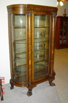 My mother's antique Ebert Curio Cabinet. It's looking for a new home.