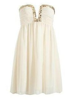 wHITE HOMECOMING DRESS WITH A SEQUINS RIM ON THE BUST
