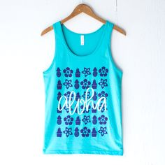 Aloha! Bright Teal tank made up of 100% Cotton, printed with Purple and White ink. Screen Printed by hand using Phthalate free inks Tee is Unisex, View the size