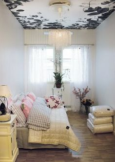 Pattern painted on ceiling. I like the way the bed is laid out. Need to do this.