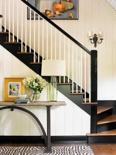 black stair risers and baseboards-WOW!! I wonder how far the black baseboards go?  wouldn't want in the whole house, but LOVE LOVE the stairs!!