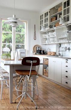 White kitchen, wood floors, open shelves,