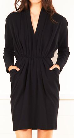 DONNA KARAN.  I have an old Donna Karan pattern very much like this.  Dig it out and make in black double knit .