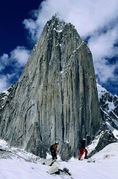 ✮ Expedition members hike along Trango Glacier before the 3,000-foot face of Name less Tower