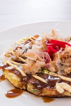 """Okonomiyaki (お好み焼き) literally means """"grilled as you like it"""", and is a savory…"""