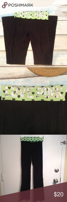 "VS PINK Bling Green Heart Waist Yoga Pants Victoria's Secret PINK classic black yoga pants with green and black heart print fold over waist and rhinestone bling ""love pink"". Has a few missing stones and some fading. Perfect for wearing around campus this back to school season. Size XS. Measures 13"" flat at waist, 33"" inseam, and 8"" ankle opening. No modeling. Smoke free home. I do discount bundles. PINK Victoria's Secret Pants Track Pants & Joggers"