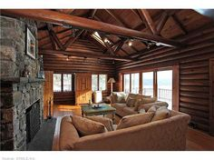 After a long day of outdoor adventuring, retreat back to this log cabin's cozy living room.