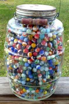 Vintage jar full of marbles ~T~ I have a jar full of marbles exactly like this. Truly this could be a picture of my jar. Love it.