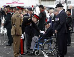 8/4/14.  Medals: Prince Harry met 88-year-old Stanley Hodge, pictured, President of the Normandy Veterans Association who undertook this year's march in a wheelchair for the first time