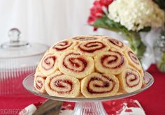 This beautiful Charlotte Royale cake recipe features slices of Swiss roll cake around a delicious vanilla-strawberry mousse filling!