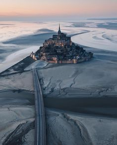 The chapel built into the Sea. Do you know that Mont Saint-Michel symbolise the structural hierarchy of feudal society On top there is Mont Saint Michel France, Le Mont St Michel, Scenery Photography, Tumblr Photography, Digital Photography, Photography Tips, Photography Equipment, World Images, Take Better Photos