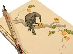 Embroidered Notebook / Crow Eating Persimmons , via Etsy.