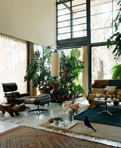 The main room often appears to be cluttered but that was tempered by white walls and floors.