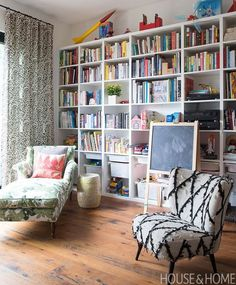 Instead of hiding toys away, the wall of bookshelves lets them take center stage and adds some visual interest to the white walls. | Designer: Litsa Trochatos Photo: Alex Lukey