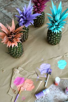 Colorful Decorated Pineapples!  - See More Lovely Pineapple Party Ideas At B. Lovely Events!