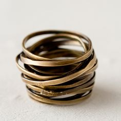 "Rugged yet polished, this chunky, brass ring from Jo Handbags is hand-hammered and shaped by skilled artisans, assuring that each piece is unique.- Brass- Size 7- Handmade in the USA1""W, 1""L"