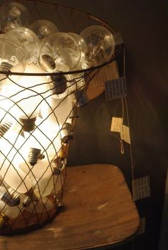 DIY :: One light bulb illuminating a bunch of burned out ones. ( Place it where no kids and clumsy adults can reach : )