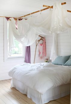 Country chic bedroom with bamboo canopy. Would be easy to make!